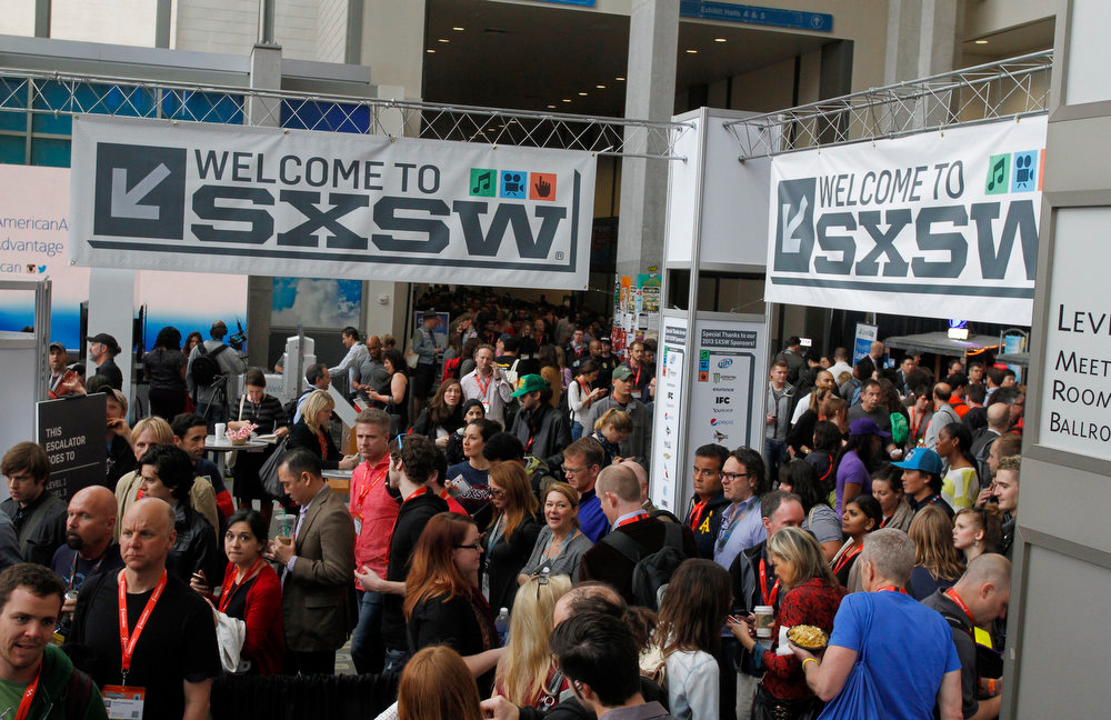 . SXSW Interactive and Film Festival attendees crowd the Austin Convention Center, Saturday, March 9, 2013 in Austin, Texas.  (AP Photo/Jack Plunkett)