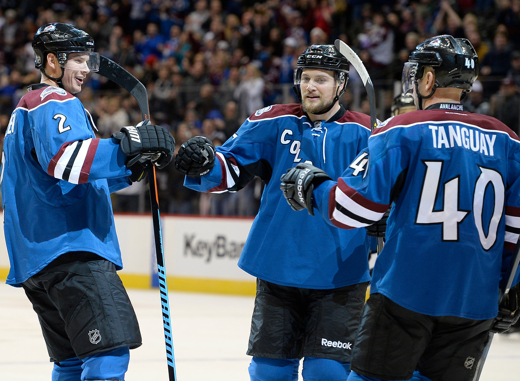 . DENVER, CO - FEBRUARY 16: Colorado Avalanche defenseman Nick Holden (2) celebrate his power play goal with Colorado Avalanche center John Mitchell (7) and Colorado Avalanche left wing Alex Tanguay (40) during the first period agains the Arizona Coyotes February 16, 2015 at Pepsi Center. (Photo By John Leyba/The Denver Post)