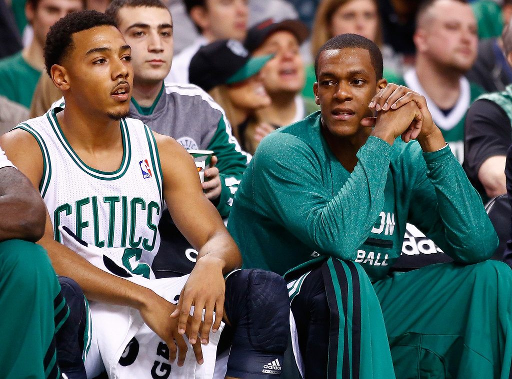 . BOSTON, MA - JANUARY 17: Rajon Rondo #9 talks to teammate Phil Pressey #26 of the Boston Celtics on the bench in the second quarter against the Los Angeles Lakers during the game at TD Garden on January 17, 2014 in Boston, Massachusetts.   (Photo by Jared Wickerham/Getty Images)