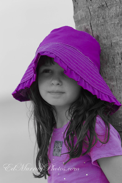 A Touch of Purple: My daughter, leaning against a palm tree....  5/2/2013