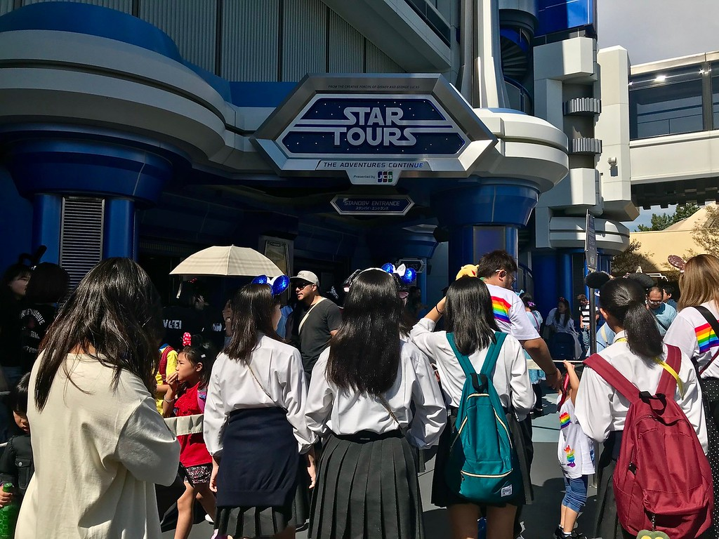 A long queue in front of the Star Tours attraction.