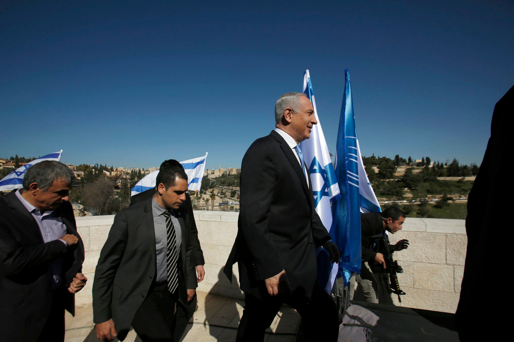 Description of . Israel's Prime Minister Benjamin Netanyahu arrives to give a statement outside the Menachem Begin Heritage Center in Jerusalem January 21, 2013. Netanyahu made an election eve appeal to wavering supporters to