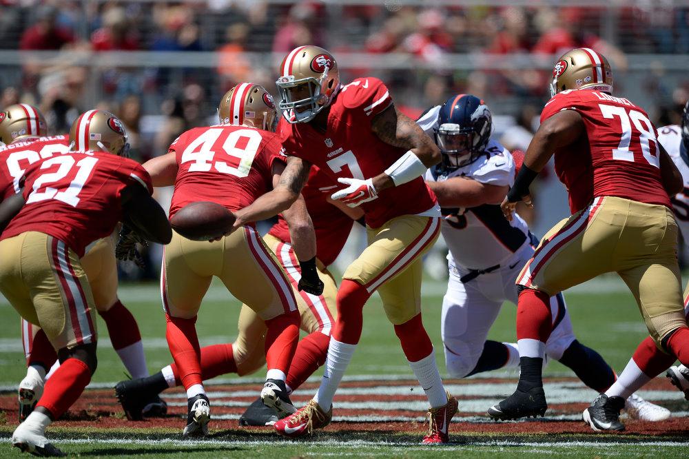 . San Francisco 49ers quarterback Colin Kaepernick (7) hands off to San Francisco 49ers running back Frank Gore (21) during the first quarter against the Denver Broncos August 17, 2014 at Levi\'s Stadium. (Photo by John Leyba/The Denver Post)