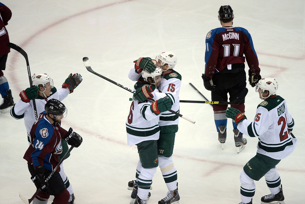 . DENVER, CO - APRIL 26: Matt Moulson (26) of the Minnesota Wild celebrates his game-tying 1-1 goal with Dany Heatley (15) as Jamie McGinn (11) of the Colorado Avalanche skates away from the action during the second period. The Colorado Avalanche hosted the Minnesota Wild during game five of the first round of the NHL Stanley Cup Playoffs at the Pepsi Center on Saturday, April 26, 2014. (Photo by Karl Gehring/The Denver Post)
