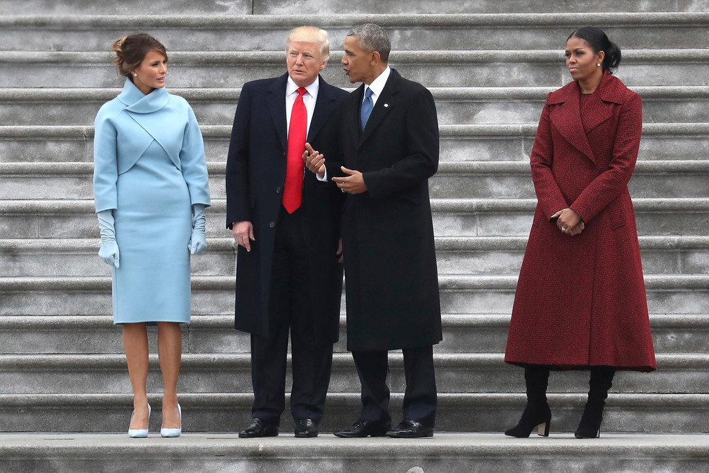 . President Donald Trump and former president Barack Obama stand on the steps of the Capitol in Washington, Friday, jan. 20, 2017, with first lady Melania Trump and Michelle Obama, prior to the Obama\'s departure to Andrews Air Force Base, Md., following the presidential inauguration. (Rob Carr/Pool Photo via AP)