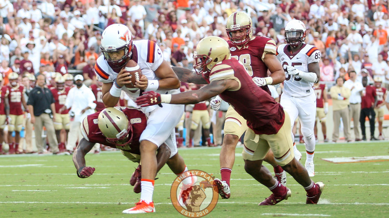 QB Brenden Motley (9) protects the football on a run to the endzone in the 4th quarter. (Mark Umansky/TheKeyPlay.com)