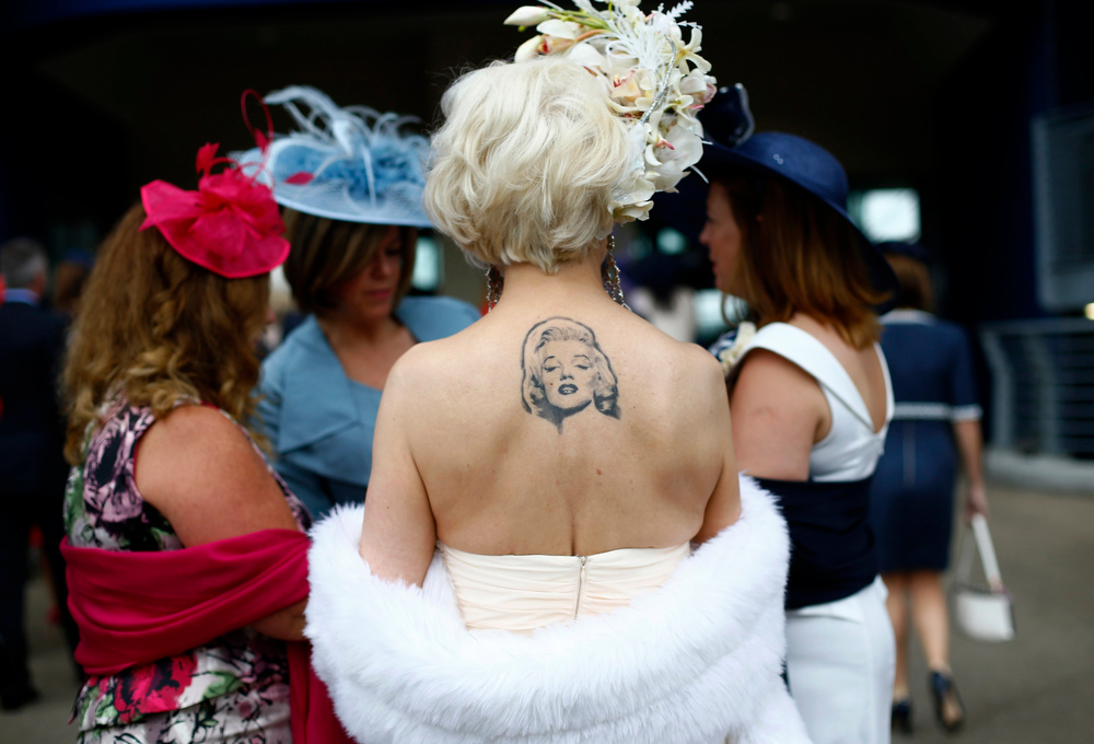 . A racegoer displays a tattoo of actress Marilyn Monroe during Ladies\' Day at the Royal Ascot horse racing festival at Ascot, southern England June 20, 2013.  REUTERS/Darren Staples