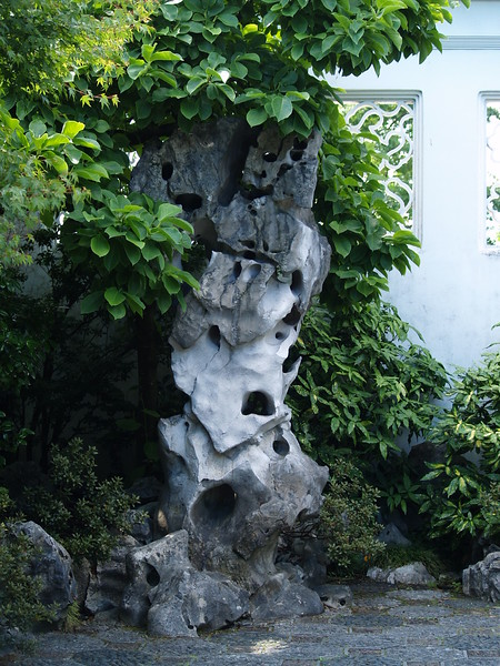 The garden is filled with green plants, rocks, water and stone. There is very little color other than white. But the subtle changes of the green hues and that of the rocks makes for a calming effect. (2009)