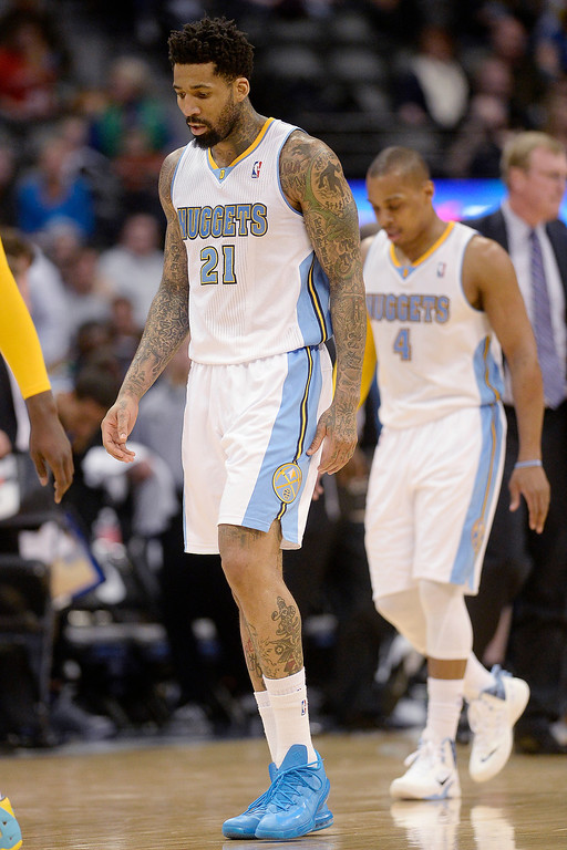 . Wilson Chandler (21) of the Denver Nuggets walks off the court against the Minnesota Timberwolves during the second quarter at the Pepsi Center. The Denver Nuggets host the Minnesota Timberwolves on Monday, March 3, 2014. (Photo By AAron Ontiveroz/The Denver Post)