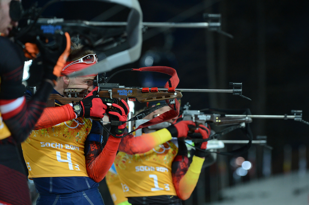. Russia\'s Dmitry Malyshko (L) and Germany\'s Arnd Peiffer compete at the shooting range in the Men\'s Biathlon 4x7.5 km Relay at the Laura Cross-Country Ski and Biathlon Center during the Sochi Winter Olympics on February 22, 2014, in Rosa Khutor, near Sochi. (KIRILL KUDRYAVTSEV/AFP/Getty Images)