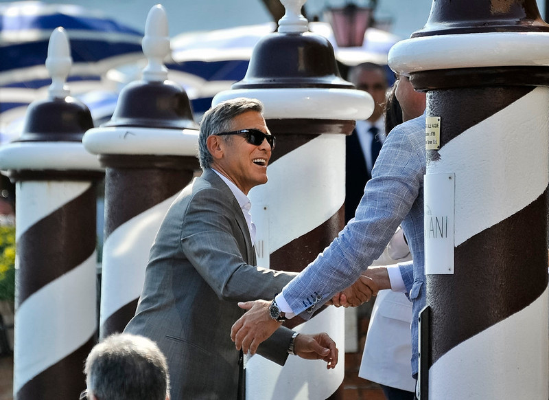 . George Clooney arrives at the Cipriani hotel in Venice, Italy, Friday, Sept. 26, 2014. George Clooney and his fiancee Amal Alamuddin arrived in Venice on Friday for their weekend wedding extravaganza, accompanied by loved ones and trailed by a clutch of photographers who recorded their passage along the picturesque Grand Canal. Clooney and his bride stood outside for the water-taxi ride, and he waved to well-wishers as they passed under the famed Rialto Bridge. The water journey ended at the luxury Cipriani Hotel, Clooney\'s usual residence when in Venice, on an island opposite St. Mark\'s Square. (AP Photo/Luigi Costantini)