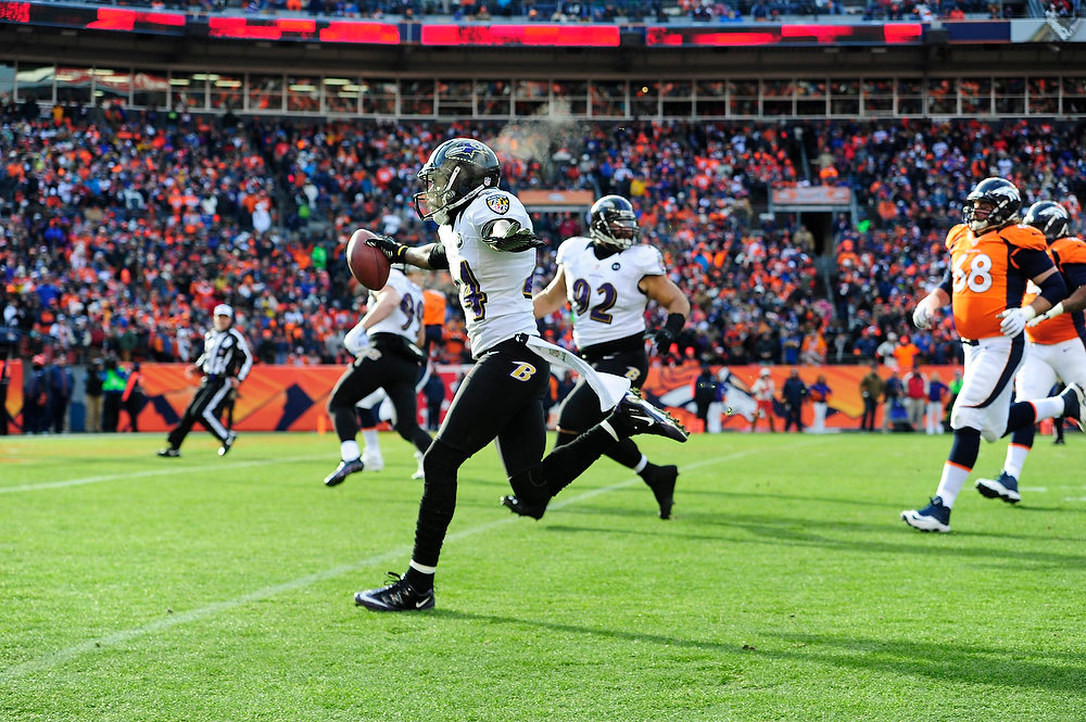 . Baltimore Ravens cornerback Corey Graham (24) returns an interception for a touchdown in the first quarter. The Denver Broncos vs Baltimore Ravens AFC Divisional playoff game at Sports Authority Field Saturday January 12, 2013. (Photo by AAron  Ontiveroz,/The Denver Post)