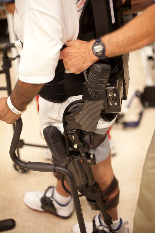 ". Richard Torres of Livingston uses ""Ekso\"" a robotic exoskeleton device at the Rehabilitation Center at Santa Clara Valley Medical Center in San Jose Wednesday, July 17, 2013. Torres is a stroke victim and he is participating in a new study to find out if the device can help him learn to walk again. The device is made by Ekso Bionics. (Patrick Tehan/Staff)"
