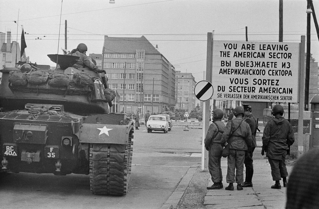 . American tanks and troops at Checkpoint Charlie, a crossing point in the Berlin Wall between the American and Soviet sectors of the city at the junction of Friedrichstrasse, Zimmerstrasse and Mauerstrasse, February 1961.   (Photo by Express Newspapers/Getty Images)