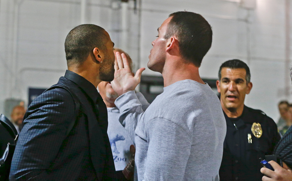 . A San Diegop police officer arrives to break up a confrontation involving Los Angeles Dodgers\' Matt Kemp, left, and San Diego Padres\' Clayton Richard after Richard stopped Kemp when he confronted the Padres\' Carlos Quentin in the tunnel walk-way exiting Petco Park following the  baseball game between the Los Angeles Dodgers and San Diego Padres in which a brawl occurred when Quentin was hit by a pitch from the Dodgers\' Zack Greinke in San Diego, Thursday, April 11, 2013. Greinke suffered a broken left collarbone in the brawl.   (AP Photo/Lenny Ignelzi)