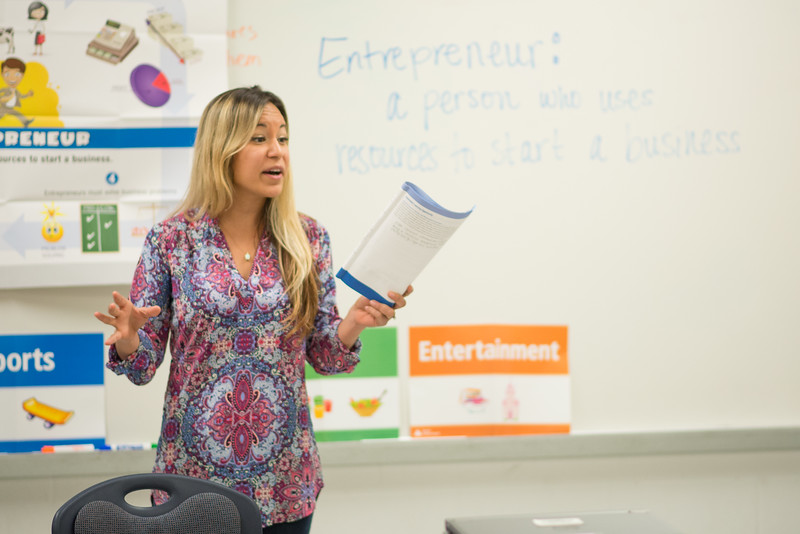 TAMU-CC student Debra Manfredi speaks to a class in Zavala Elementary on the topic of different types of Entreprenuership opportunities.