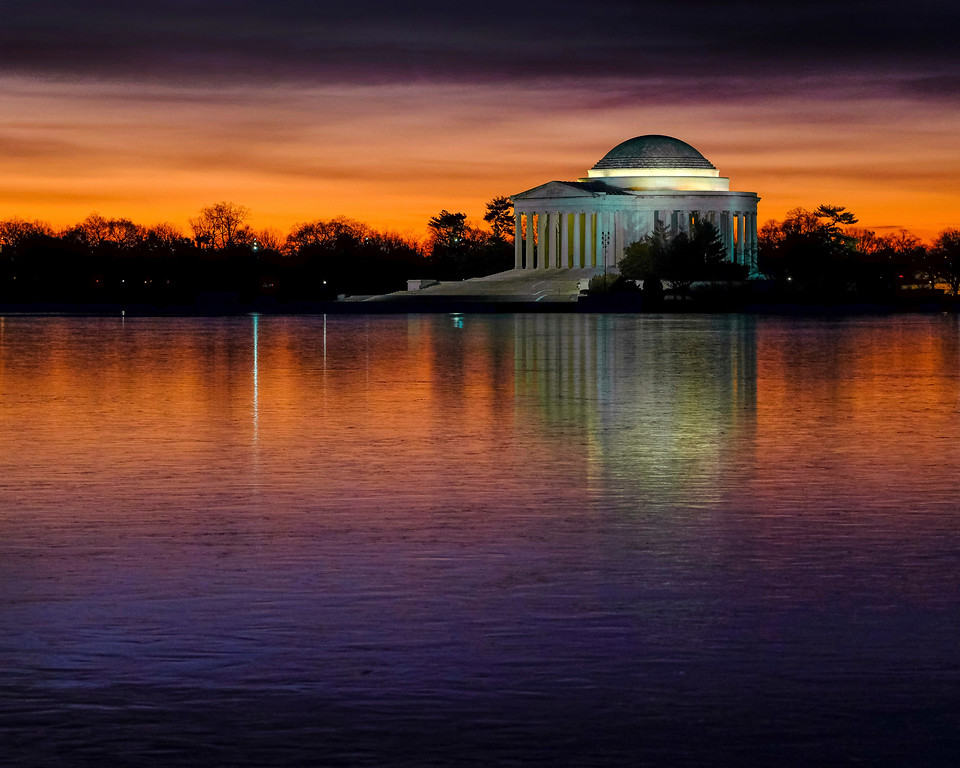 . The Jefferson Memorial is reflected on the frozen surface of the Tidal Basin at daybreak on a cold morning in Washington, Monday, Jan. 9, 2017. (AP Photo/J. David Ake)