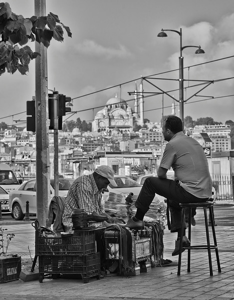 local man having his shoes polished early in the morning before heading to work.  Istanbul, Turkey 2016.