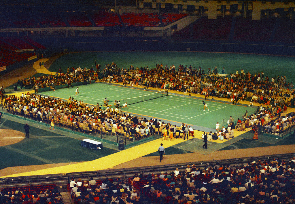 """. Tennis star Bobby Riggs, right side, and Billie Jean King are shown in action during the \""""Battle of the Sexes\"""" match in the Astrodome in Houston, Tex., Sept. 20, 1973.  (AP Photo)"""