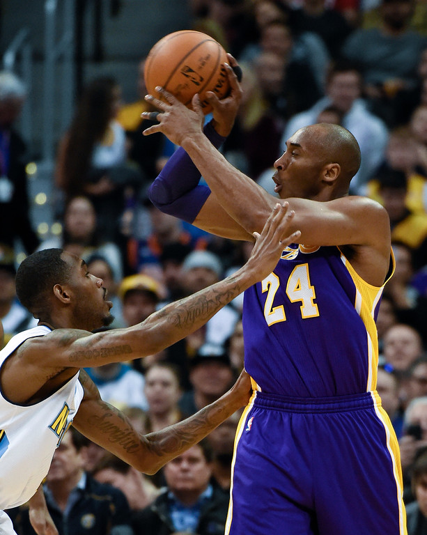 . DENVER, CO - MARCH 02: Los Angeles Lakers forward Kobe Bryant (24) makes a pass over Denver Nuggets forward Will Barton (5) March 2, 2016 at Pepsi Center. (Photo By John Leyba/The Denver Post)