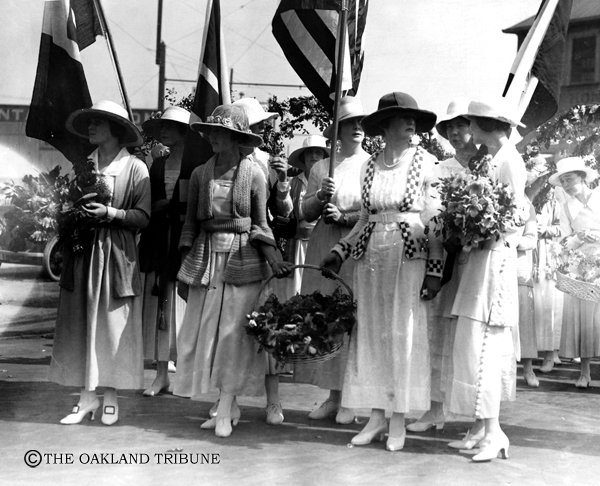 ". Oakland, CA September 18, 1919 - Young women bear flowers and flags for the President and Mrs. Woodrow Wilson. (E. A. ""Doc\"" Rogers / Oakland Tribune Staff Archives)"