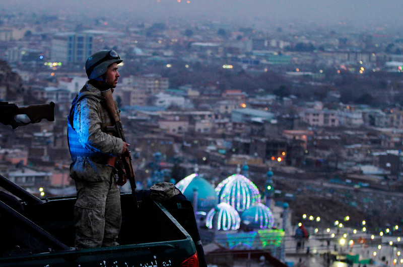 . An Afghan Army soldier secures the hill overlooking the Kart-e Sakhi mosque in Kabul, Afghanistan, Wednesday, March 20, 2013. Thousands of Afghans will celebrate Nowruz on Thursday, March 21, 2013 to mark the first day of spring and the beginning of the year on the Iranian calendar. (AP Photo/Ahmad Jamshid, File)