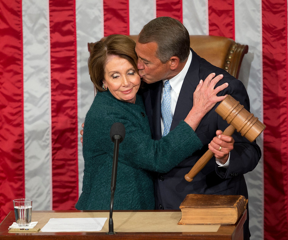 . House Speaker John Boehner of Ohio, kisses House Minority Leader Nancy Pelosi of Calif. after being re-elected to a third term during the opening session of the 114th Congress, as Republicans assume full control for the first time in eight years, Tuesday, Jan. 6, 2015, on Capitol Hill in Washington. AP Photo/Pablo Martinez Monsivais )