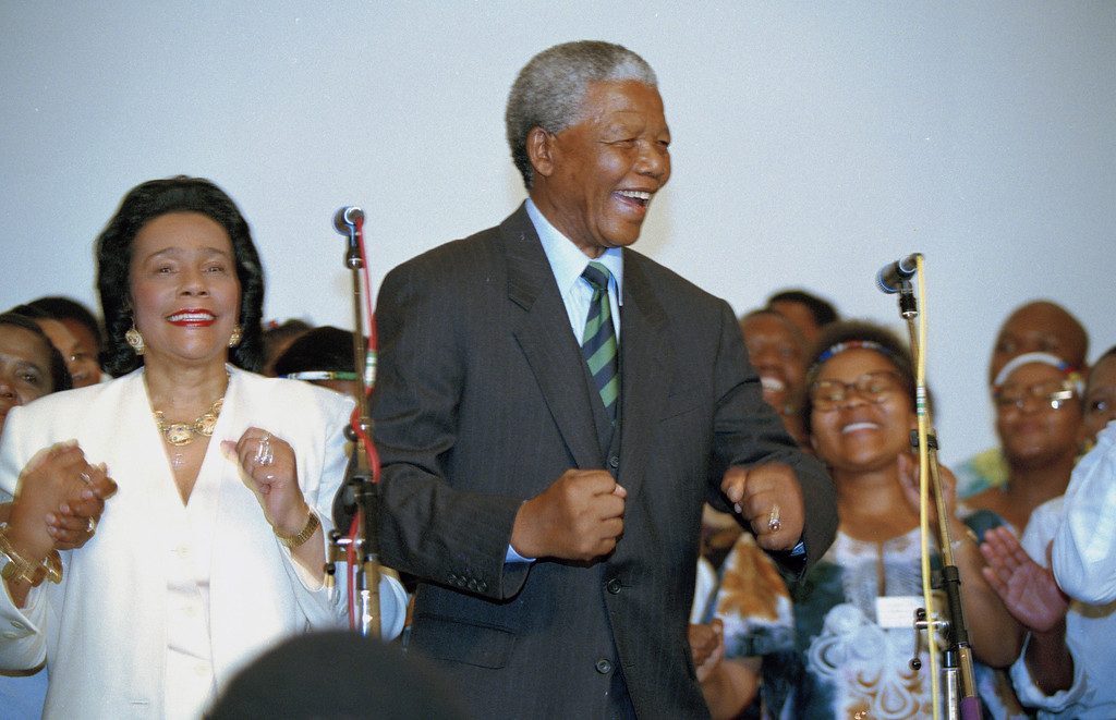 . Nelson Mandela, African National Congress leader, and Coretta Scott King, widow of slain civil rights leader Martin Luther King, Jr., sing and dance at a victory celebration for Mandela in Johannesburg, May 2, 1994, after Mandela and the ANC appeared to take the majority of the votes in the country\'s first integrated elections.  (AP Photo/David Brauchli)