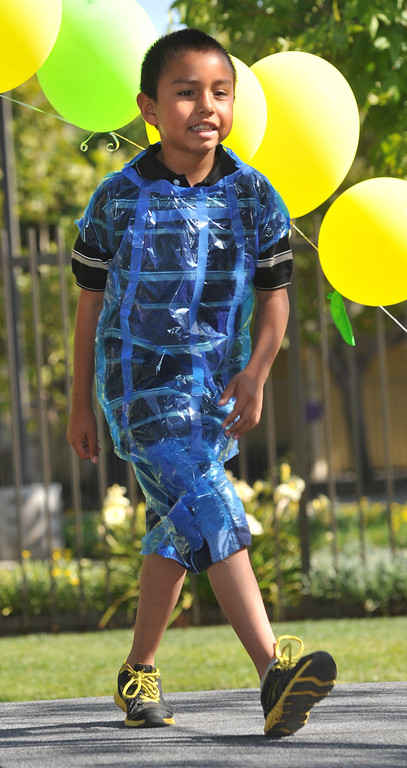 """. Angel Vargas, 7, shows his wearable art in the \""""Art of Recycling\"""" showcase at the Community Resource Center in South Whittier on Thursday June 20, 2013. Students from the CRC�s Homework Assistance Program will join other local artists to showcase their wearable art made from 100% recyclable items such as newspaper, plastics, can tabs, candy wrappers, and other materials that most people toss in the trash. (SGVN/Staff Photo by Keith Durflinger)"""