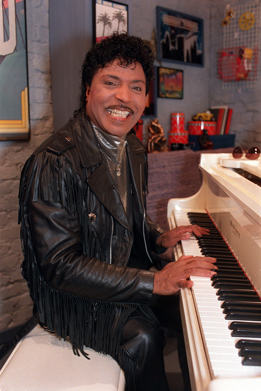 . Little Richard plays the piano during taping at The Movie Channel Inc., in New York City, Thursday, Jan. 22, 1988.  Little Richard will be acting as a host of four segments of Turner Movie Channel presentations by introducing his favorite films while seated at the piano.  (AP Photo/Mark Lennihan)