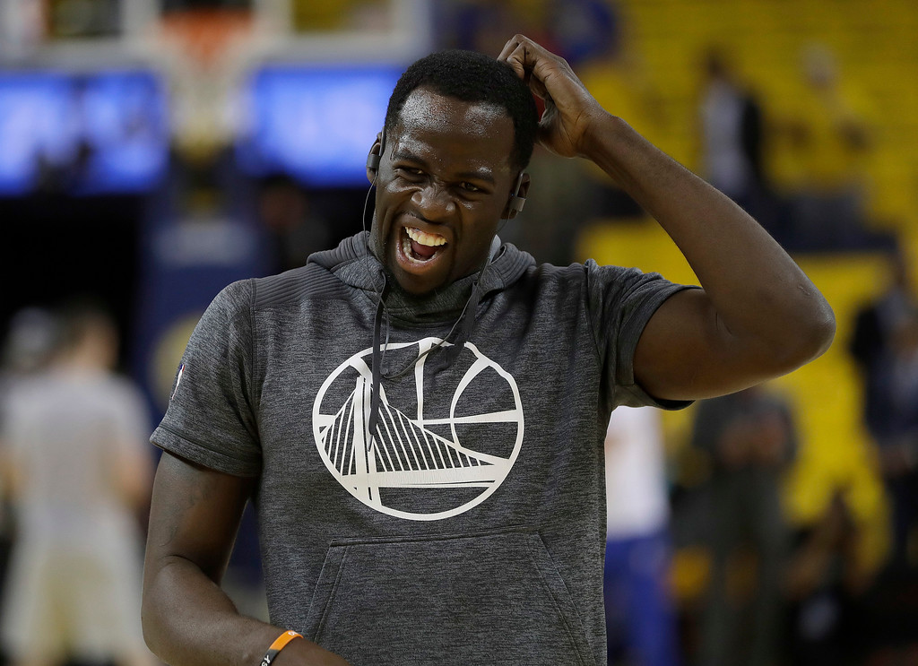 . Golden State Warriors forward Draymond Green warms up before Game 1 of basketball\'s NBA Finals between the Warriors and the Cleveland Cavaliers in Oakland, Calif., Thursday, June 1, 2017. (AP Photo/Marcio Jose Sanchez)