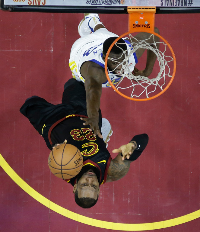 . Cleveland Cavaliers forward LeBron James (23) shoots over Golden State Warriors forward Draymond Green (23) in the first half of Game 3 of basketball\'s NBA Finals, Wednesday, June 6, 2018, in Cleveland. (AP Photo/Carlos Osorio, Pool)