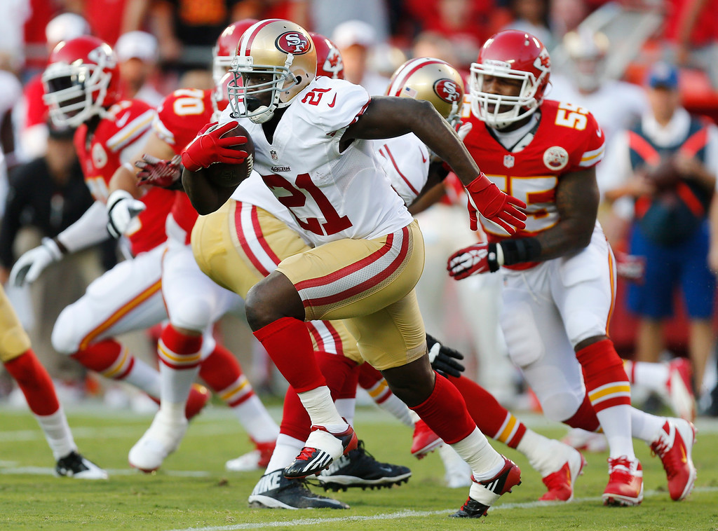 . San Francisco 49ers running back Frank Gore (21) rushes for positive yards during the first half of an preseason NFL football game against the Kansas City Chiefs at Arrowhead Stadium in Kansas City, Mo., Friday, Aug. 16, 2013. (AP Photo/Ed Zurga)