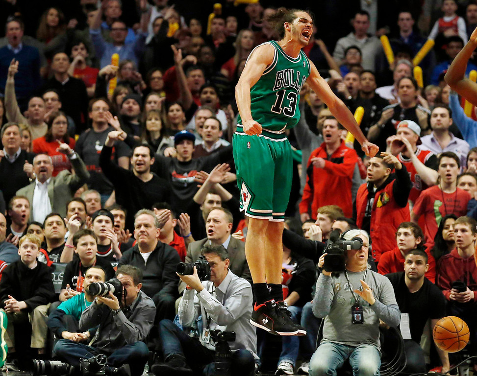 . Chicago Bulls\' Joakim Noah reacts to a call by the referee during the overtime of their NBA basketball game against the Denver Nuggets in Chicago, Illinois March 18, 2013.  REUTERS/Jim Young