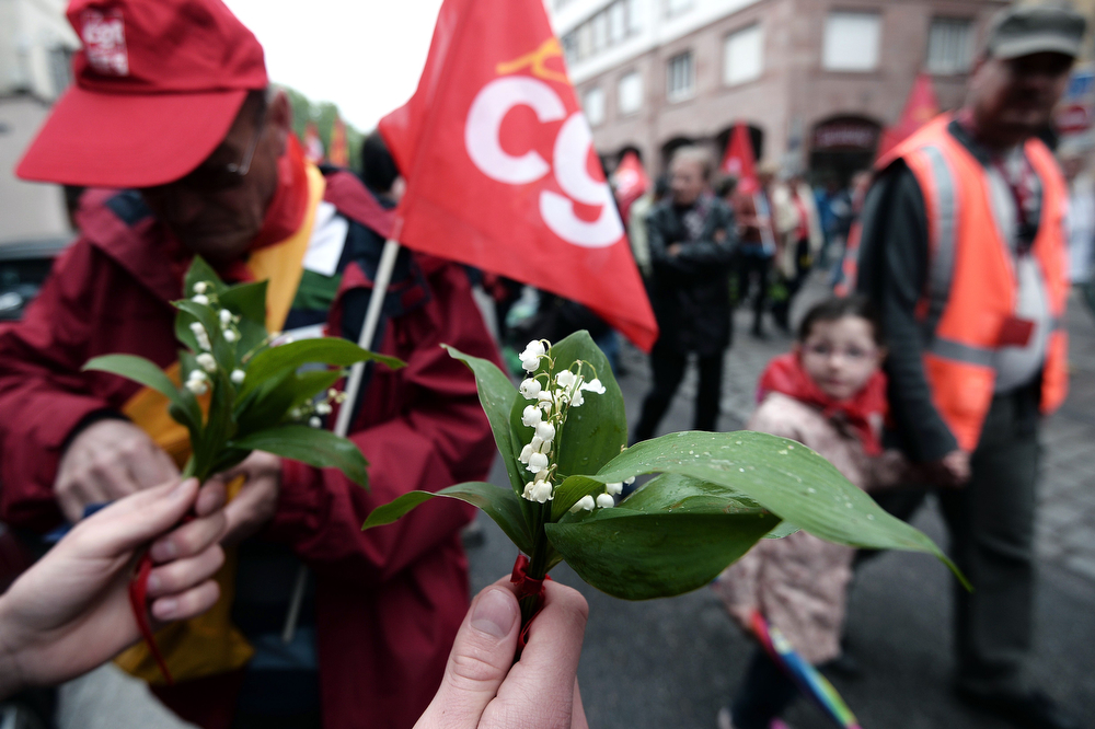 . A lily of the valley is shown as people gather during a May Day rally of unions on May 1, 2014 in Strasbourg, eastern France. (FREDERICK FLORIN/AFP/Getty Images)
