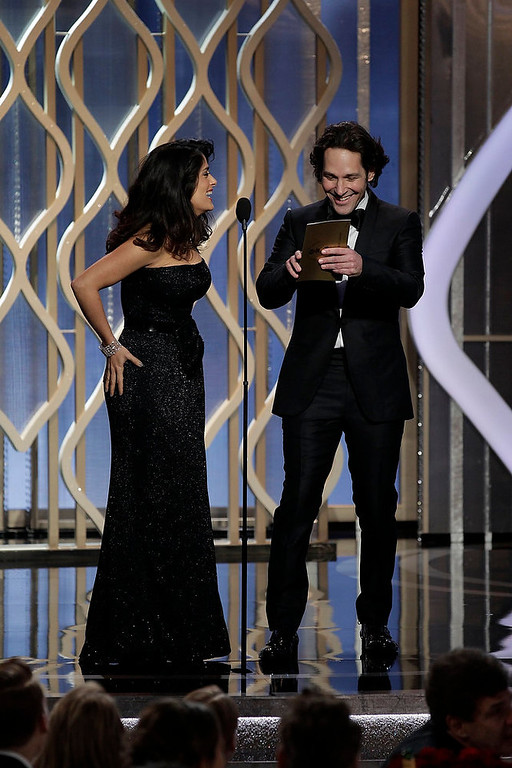 . Presenters Salma Hayek (L) and Paul Rudd on stage at the 70th annual Golden Globe Awards in Beverly Hills, California January 13, 2013, in this picture provided by NBC. REUTERS/Paul Drinkwater/NBC/Handout