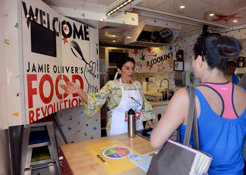 """. Program Trainer Lisa Fontanesi talks about the Jamie Oliver Food Foundation\'s \""""Big Rig Teaching Kitchen\"""" at the L.A. County Fair at Fairplex in Pomona. (Jennifer Cappuccio Maher/Inland Valley Daily Bulletin)"""