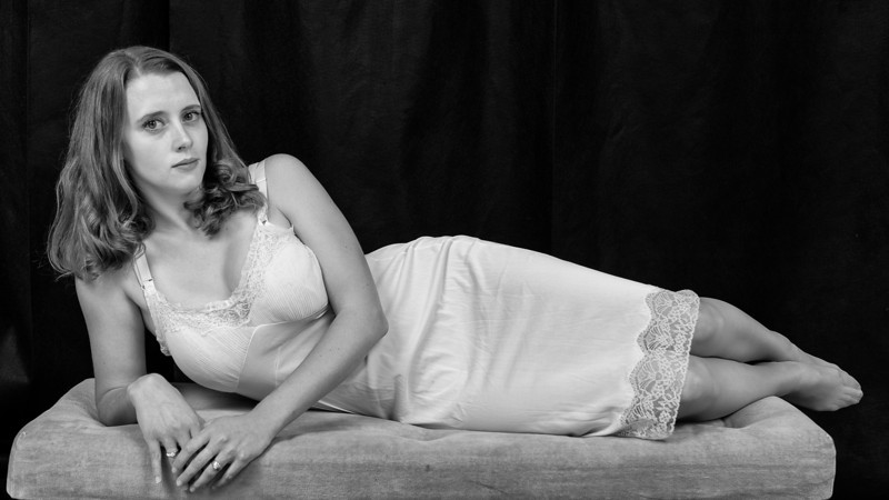 Madeleine Lambert reclining as Maggie in Cat on a Hot Tin Roof, WHAT and Provincetown Tennessee Williams Theater Festival (©2013 by Michael Karchmer)