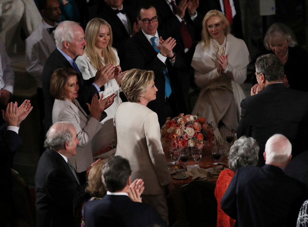 . Hillary Clinton stands as she is recognized by President Donald Trump during his speech at the inaugural luncheon at the Statuary Hall in the Capitol, Friday, Jan. 20, 2017, in Washington. (AP Photo/Manuel Balce Ceneta)