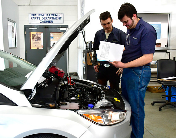 2/5/2019 Mike Orazzi | Staff H.H. Ellis Technical High School students Max Degnim and Joshua Sychevsky work on repairing vehicles during part of the 2019 CARA Challenge Tuesday morning in Plainville.
