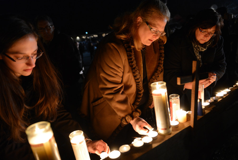 Description of . People gather for a prayer vigil at St Rose Church following an elementary school shooting in Newtown, Connecticut, December 14, 2012.  A young gunman slaughtered 20 small children and six teachers on Friday after walking into a school in an idyllic Connecticut town wielding at least two sophisticated firearms. EMMANUEL DUNAND/AFP/Getty Images