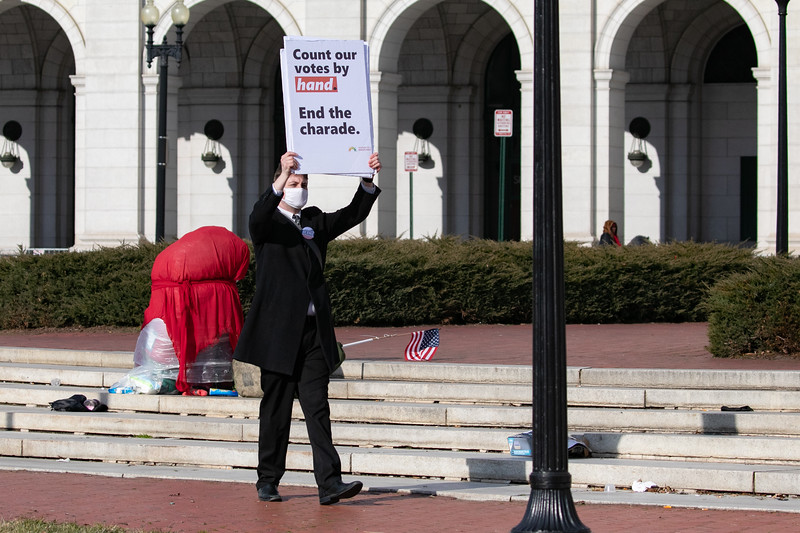 A demonstrator pickets outside of Union Station after the inaugural ceremonies