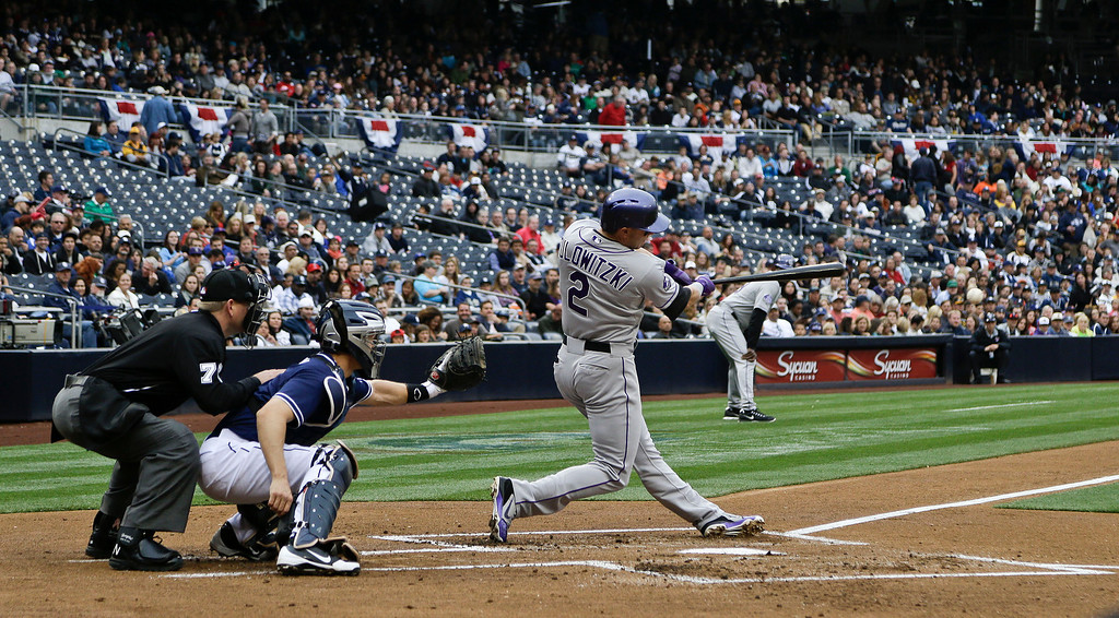 . Colorado Rockies\' Troy Tulowitzki (2) drives a double down the left field line to score the first Rockies run against the San Diego Padres in the first inning of a baseball game on Saturday April 13, 2013, in San Diego. (AP photo/Lenny Ignelzi)