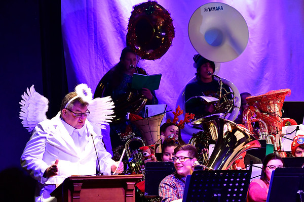 12/14/2019 Mike Orazzi | Staff Michael Schroeder, editor and publisher of the Bristol Press and New Britain Herald as the Herald Angel during the annual TubaChristmas concert held at Trinity-on-Main in downtown New Britain on Saturday.