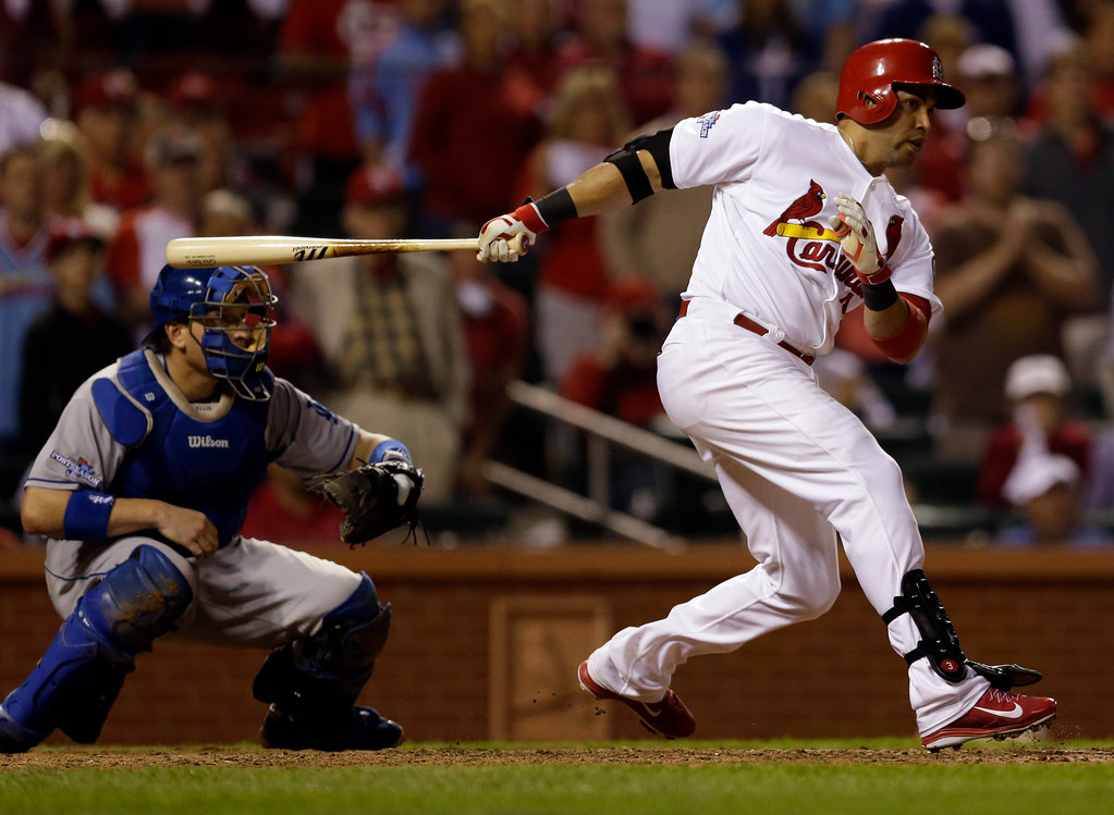 . St. Louis Cardinals\' Carlos Beltran hits his game-winning hit during the 13th inning of Game 1 of the National League baseball championship series against the Los Angeles Dodgers Saturday, Oct. 12, 2013, in St. Louis. (AP Photo/Jeff Roberson)