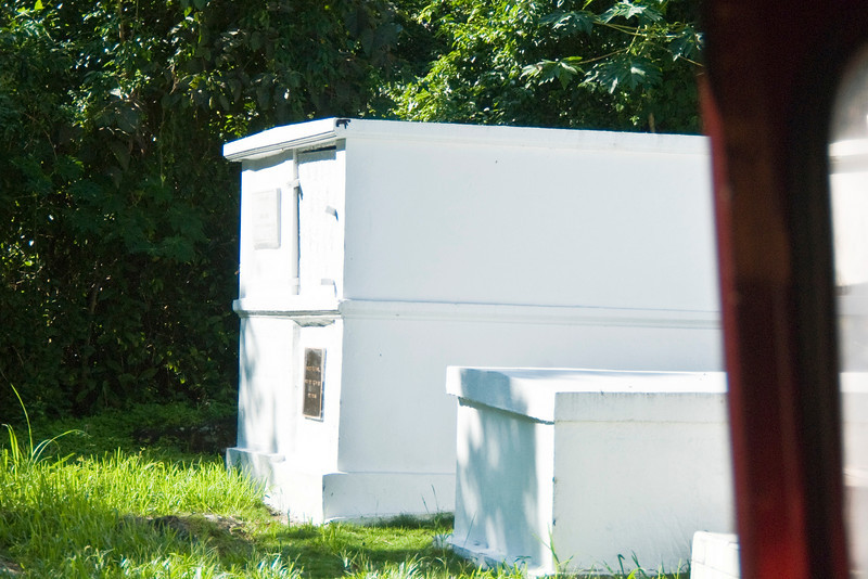 Family burial vaults placed in small lots along side the road.