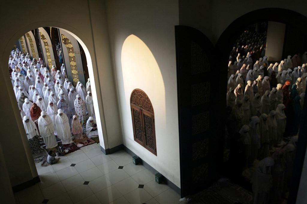 . Indonesian Muslim women attend early morning Eid al-Fitr prayers at the Al Akbar mosque in Surabaya, eastern Java island on August 8, 2013. Tens of millions of Muslims in Indonesia celebrated the Eid al-Fitr holiday on August 8 following the end of Ramadan. JUNI KRISWANTO/AFP/Getty Images