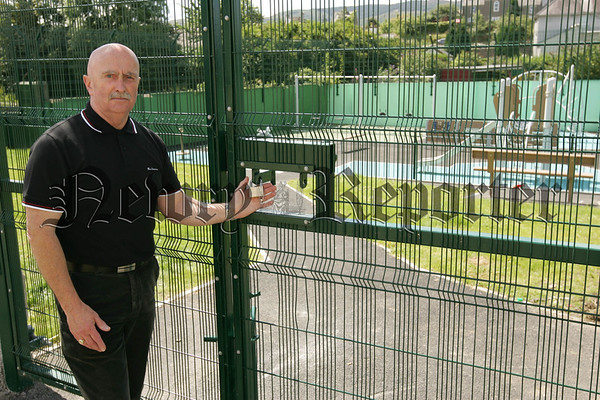 Deputy Mayor Charlie Casey pictured outside the locked gates to a new Childrens Playground in Emmett Street which has yet to open to the public. 07W32N27