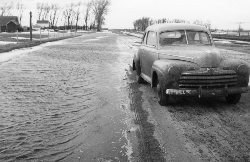 AR049.  Car on flooded road – spring flooding – 1948‡.jpg