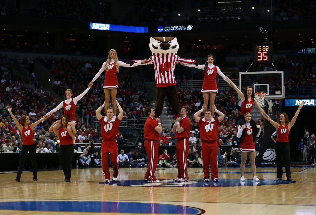 . The Wisconsin Badgers mascot, Bucky Badger, performs with cheerleaders during the second round game of NCAA Basketball Tournament against the American University Eagles at BMO Harris Bradley Center on March 20, 2014 in Milwaukee, Wisconsin.  (Photo by Jonathan Daniel/Getty Images)